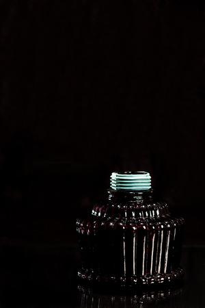 purge: Deep red glass tobacco smoking hookah on the dark background.