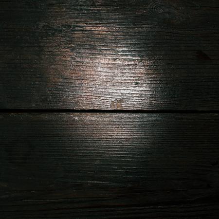 venge: Textural image: mahogany black surface of wooden board