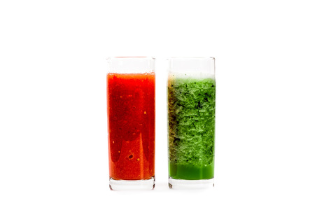 pulpy: Fresh pulpy juices or smoothies of tomato and cucumber isolated over white background. Stock Photo