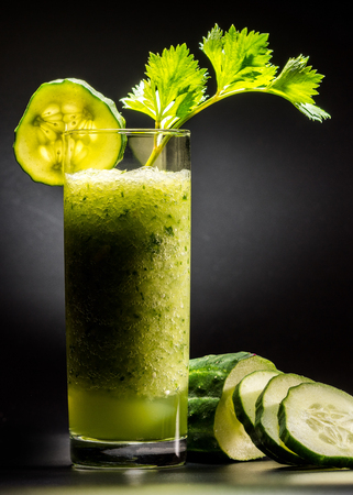 pulpy: Fresh pulpy juice or smoothie of cucumber, broccoli or celery over black background.