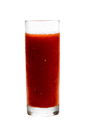 pulpy: Fresh pulpy juice or smoothie of red tomato over white background.