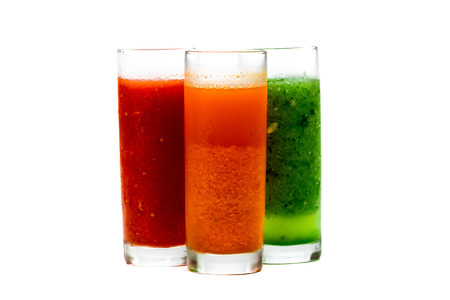 pulpy: Fresh pulpy juices or smoothies of tomato, carrot and cucumber isolated over white background. Stock Photo
