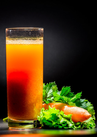 pulpy: Fresh pulpy juice or smoothie of carrot over black background.