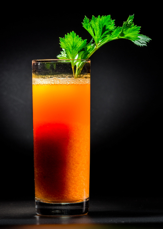 pulpy: Fresh pulpy juice or smoothie of carrot over black background. Concept of healthy eating Stock Photo