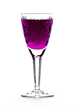 cutglass: Wineglasses of cut-glass full of colorful liquids over white background
