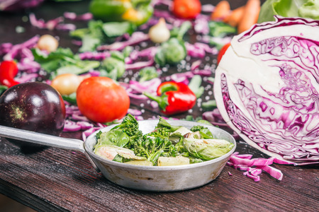 broccoli sprouts: Green and red cabbage, broccoli, brussel sprouts, carrot, paprika, chili, tomatoes and other vegetable on the dark wooden surface