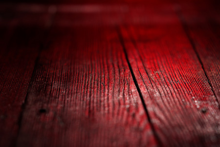 venge: Textural image: red-lighted surface of wooden board Stock Photo