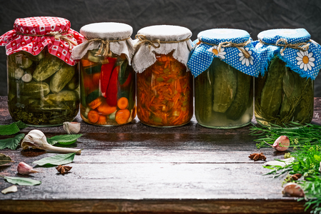 canning: Jars of pickles on the table with spices for canning