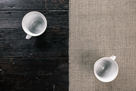 two and a half: Still life with two empty tea cups on the half covered table. Flat lay
