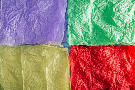 crumpled tissue: Textured background of for quarters colorful crumpled tissue paper Stock Photo
