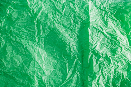 crumpled tissue: Textured background of colorful green crumpled tissue paper