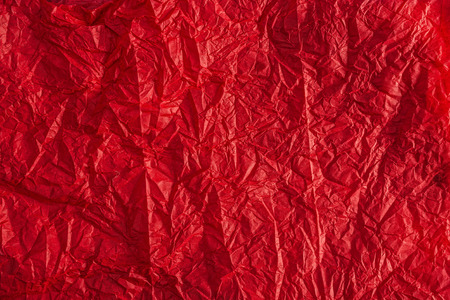 crumpled tissue: Textured background of red crumpled tissue paper Stock Photo