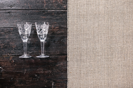two and a half: Still life with two empty wineglasses on the half covered table. Flat lay Stock Photo