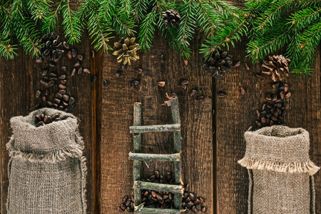 spattering: Pine nuts spattering from pine cones to bags of sackcloth under the top evergreen frame
