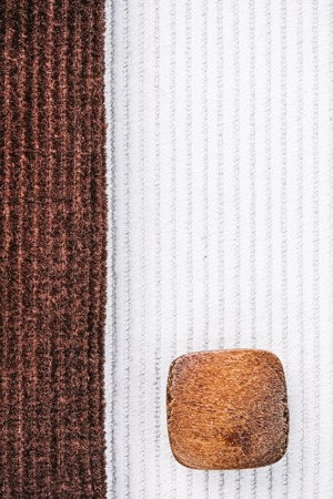corduroy: Milky white and chocolate brown corduroy combination with wood buttons. Macro view