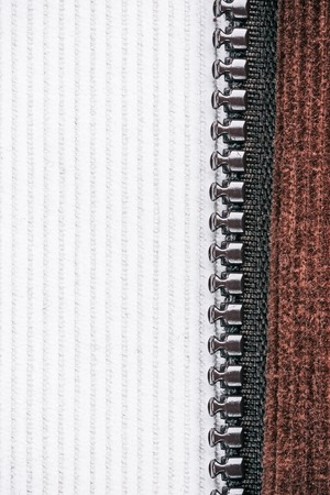 corduroy: Milky white and chocolate brown corduroy combination with dark brown zipper. Macro view