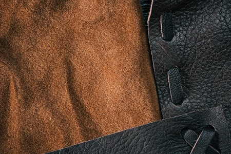suede: Combined background of brown suede and stitched leather. Macro view