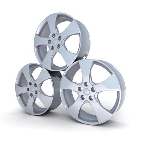 three motor car disc on a white background     photo
