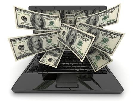 錢: 黑色的筆記本電腦和金錢