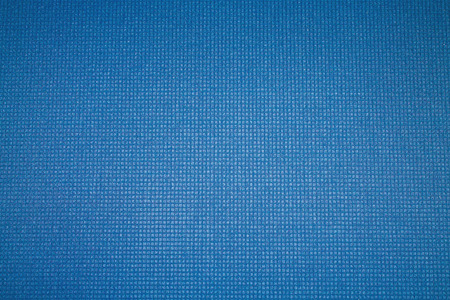 Blue background. Mat for sport, yoga and meditation. Stock Photo