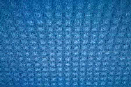 Blue background. Mat for sport, yoga and meditation. Imagens