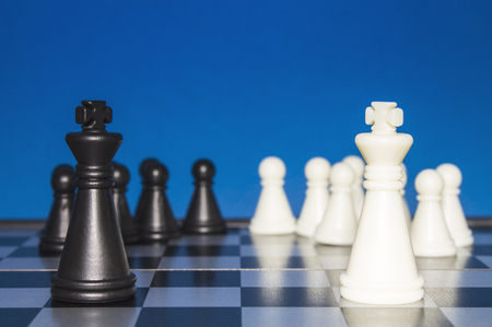 Chess as a policy. Black figure with a black team against a white figure with a white team.