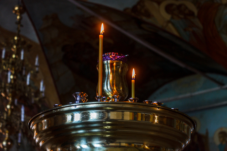 Altar with burning candles in a religious temple. Stock Photo