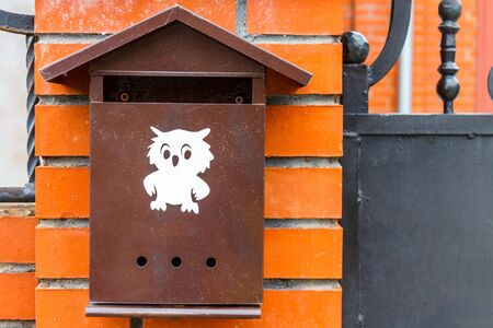 A beautiful mailbox hangs waiting for newspapers, parcels and letters from friends.