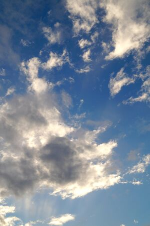Large white cumulus clouds on a blue sky for background or ecology or nature. Summer sky.