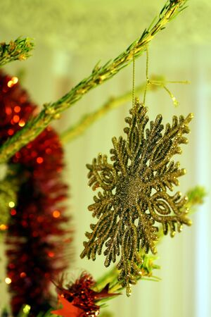 Bright and shiny decorations for Christmas and New Year hang on a green spruce. Winter holidays. Stok Fotoğraf