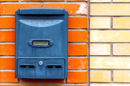 A beautiful mailbox hangs waiting for newspapers, parcels and letters from friends. Stok Fotoğraf - 132115627
