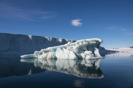 touchstone: Icebergs at Champ Island beatiful day reflation in the water , Franz Jozef Land Stock Photo