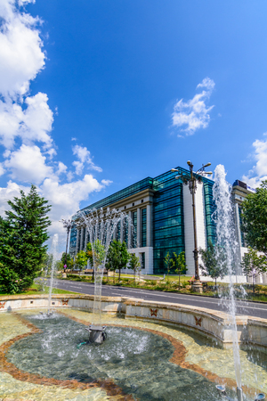 foreign national: BUCHAREST, ROMANIA - AUGUST 30 , 2015: The National Library on Splaiul Unirii in a sunny day with Dambovita river in front
