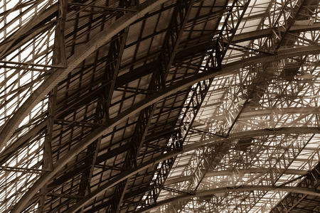 steel structure: The steel structure of the train station roof over grey background