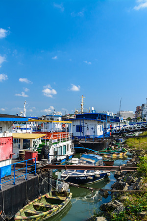 house float on water: TULCEA, ROMANIA - October 1: Tulcea on October 1, 2015 in Romania. Panoramic landscape of seafront, boats on the water, sign Tulcea