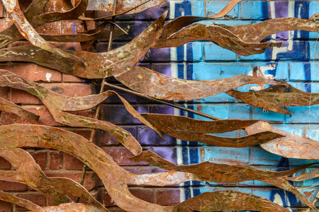 metal pattern: Close-up of a metal design resembling leaves. Horizontal view of a rusty handmade metal design.