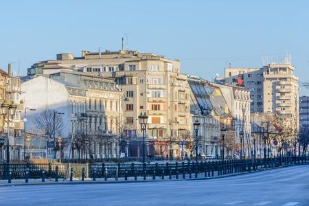 emty: Bucharest, Romania - January 10: Downtown Bucharest on January 10, 2016 in Bucharest. Buildings, emty street, blue sky, Dambovita River in Bucharest.