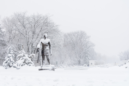 charles de gaulle: Statue covered with snow in park. Charles de Gaulle Statue in Herastrau Park, Bucharest, Romania. Stock Photo