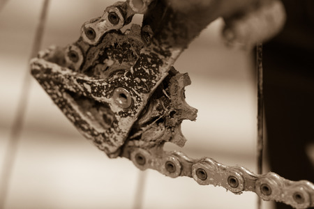 Bike gears with chain (selective focus). Messy close up of bicycle gear with details, chain and gearshift mechanism.
