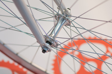 spokes: Bicycle spoke detail closeup. Detail view with hub and spokes of one bicycle wheel.