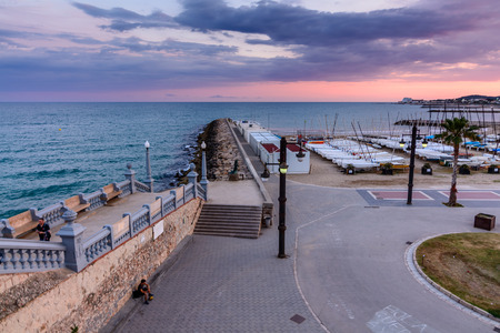 Sitges, Spain - June 10: View with Spain beach and promenade area on June 6, 2016 in Sitges, Spain. This coastal city in Catalonia is famous for its Film Festival and Carnival. Stock Photo