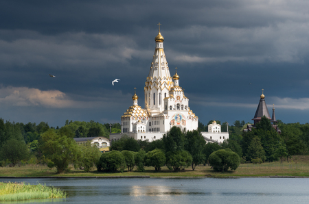 All Saints Church In Minsk, Belarus. Memorial church of All Saints and in memory of the victims, which served as our national salvation.Church with gold domes against the background of a stormy sky Reklamní fotografie