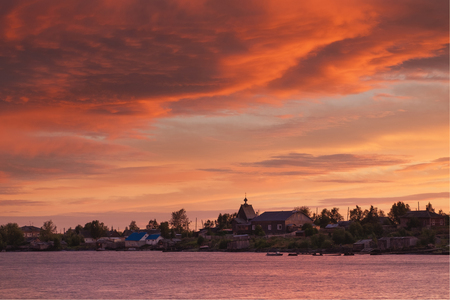 Beautiful sunset sky and clouds after a thunderstorm. Village Rabocheostrovsk, Republic of Karelia, Russia, the coast of the White Sea Reklamní fotografie