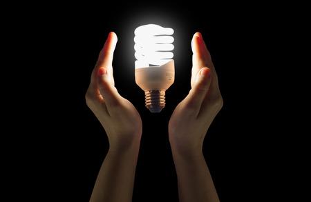 fluorescent light: Hands in the glow of fluorescent light