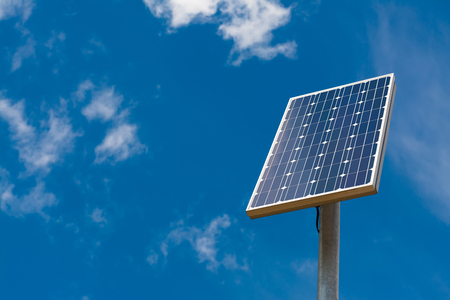 electricity generator: Solar panel against a blue sky with light clouds