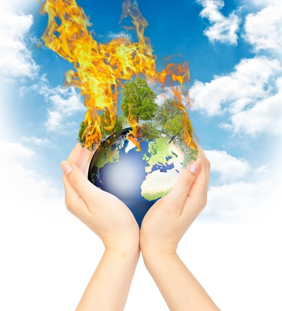 greenhouse effect: Womanish hands holding burning Earth as a symbol of global warming or an apocalypse. Stock Photo