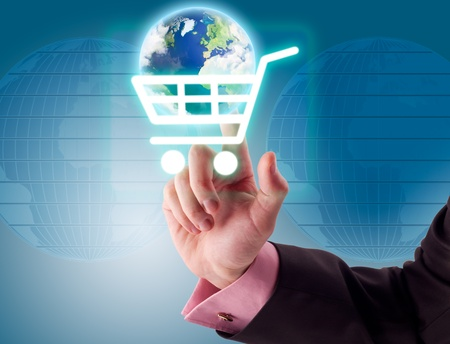 Man hand pressing shopping cart icon with Earth. Concept internet shopping. Stock Photo - 9665589