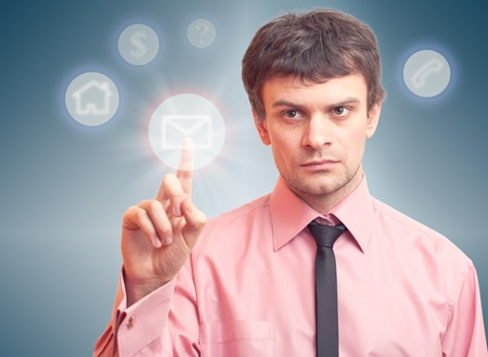 Business man pressing a digital button of message Stock Photo - 9741640