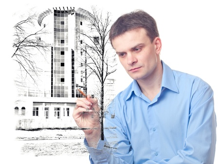 Businessman designs a Office Building on white background photo
