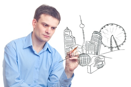 Businessman drawing a city of the future on white background. Stock Photo - 9741618